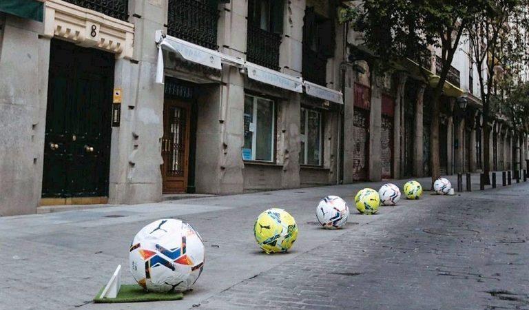 Madrid decora algunes pilones com pilotes de futbol i ha de fer marxa enrere per evitar lesions